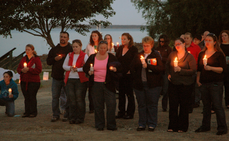A vigil is held Friday at Belfast City Park for Lynn Arsenault, who was fatally shot Aug. 28 in her Belfast home. Todd Gilday of Belfast has been charged in the attack that also wounded Arsenault's youngest son.