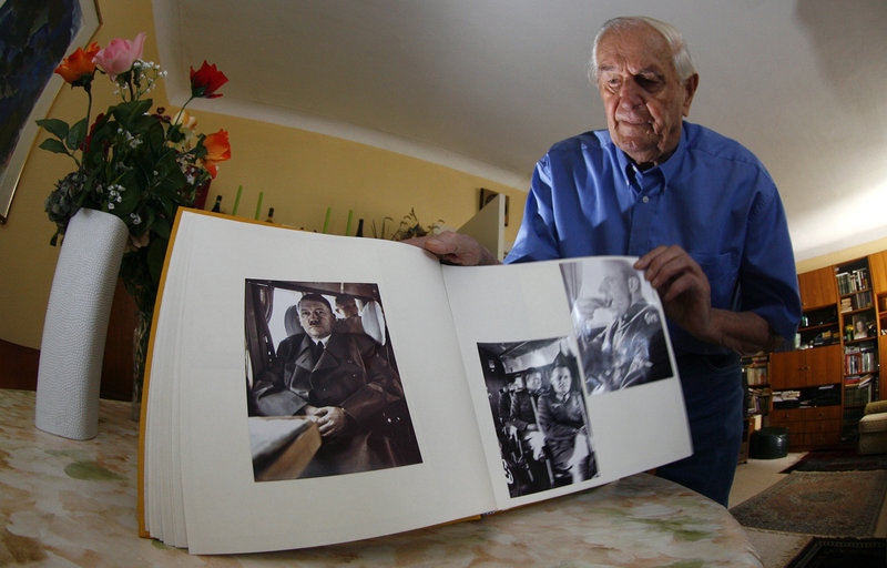 Rochus Misch, who worked as a courier, bodyguard and telephone operator for Adolf Hitler, shows his picture book during a Reuters interview in Berlin in 2007. Misch, who died Thursday at the age of 96, was with Hitler until the end.