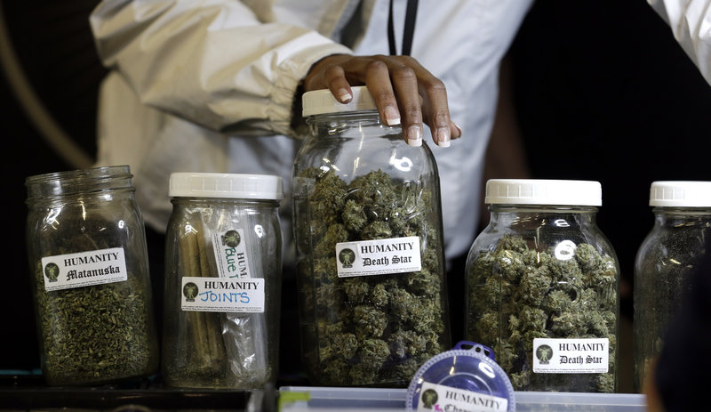 Strains of marijuana are displayed during the grand opening of the Seattle location of the Northwest Cannabis Market. The market hosts nine permanent vendors, as well as daily vendors of a variety of dried medicines.