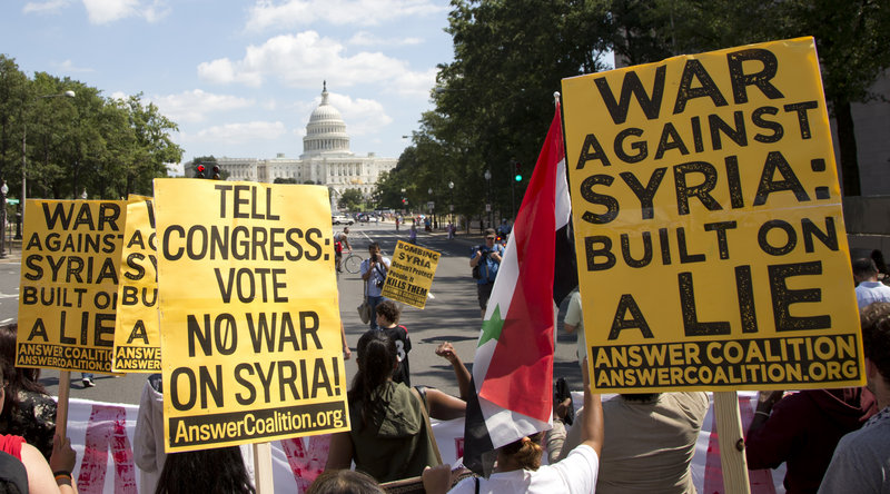 Protesters against U.S. military action in Syria march to Capitol Hill from the White House in Washington on Saturday. President Obama has asked Congress to approve the use of force following a deadly chemical gas attack on Aug. 21.