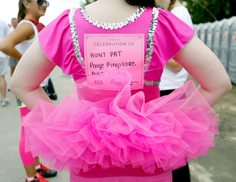 Fiona Markley of Falmouth is one of many to wear a pink outfit while participating in the Susan G. Komen Maine Race in Portland on Sunday.