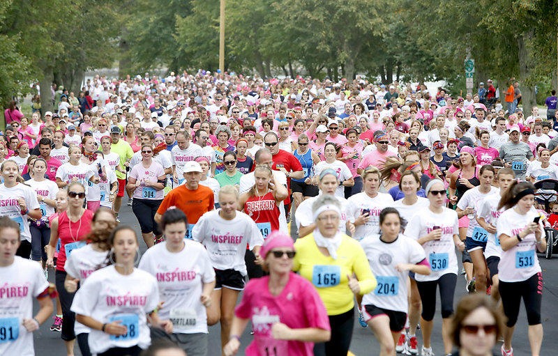 Susan G. Komen Maine Race for the Cure participants start off from Payson Park in Portland on Sunday. Many run or walk the route in honor of loved ones.