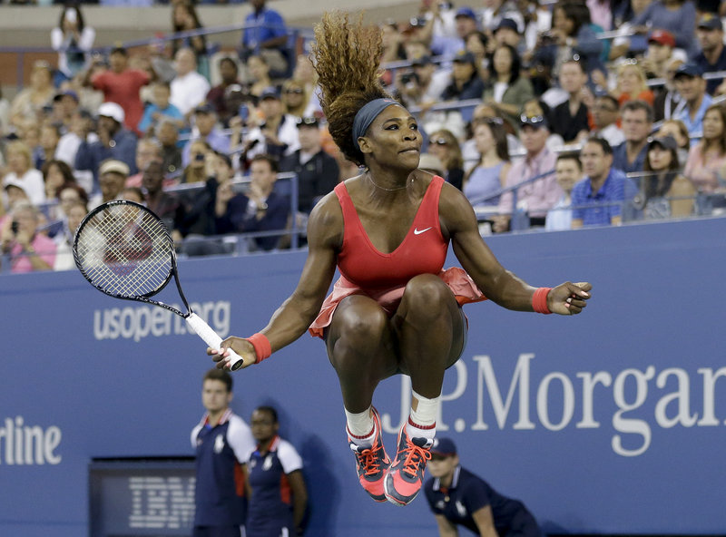 Serena Williams reacts after Sunday's victory, which raised her Grand Slam singles title count to 17, the sixth most in women's tennis history.