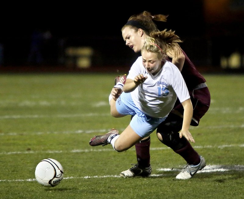 Cassie Symonds, in white, of Windham is a junior midfielder who provides a solid link between the defense and the front line.