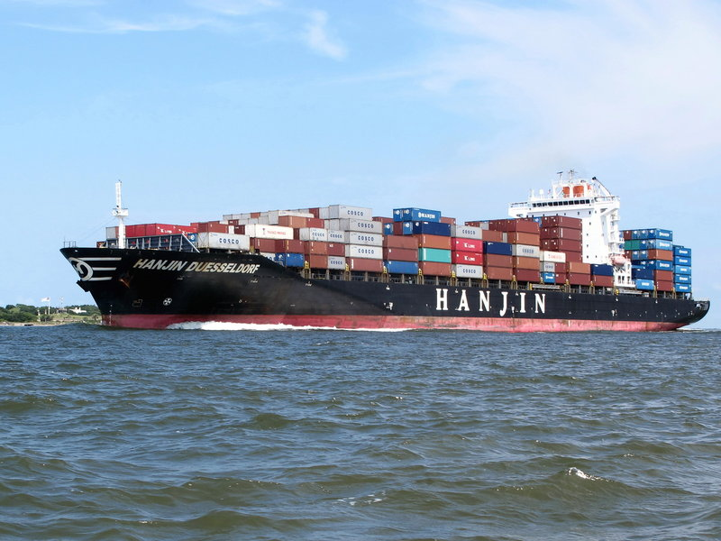 A container ship moves into the harbor in Charleston, S.C. Attendees at a trade conference on the nearby Isle of Palms, S.C., were told Tuesday that the worldwide trend toward larger container ships can affect shipping customers by requiring more time to load and unload ships and causing congestion at ports.