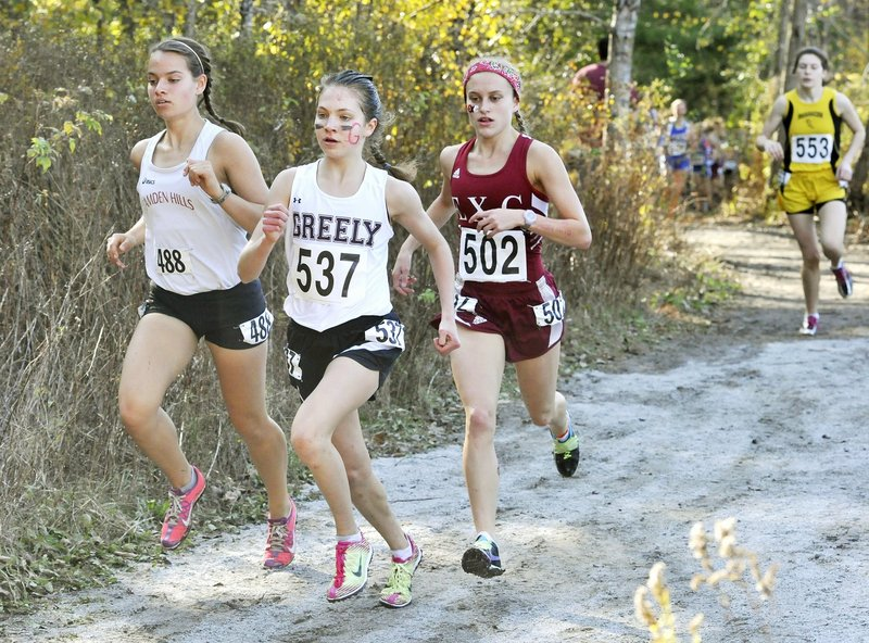 Kirstin Sandreuter of Greely, center, and Brittany Bowman of Camden Hills, left, will be close again this year while competing for the Class B title.