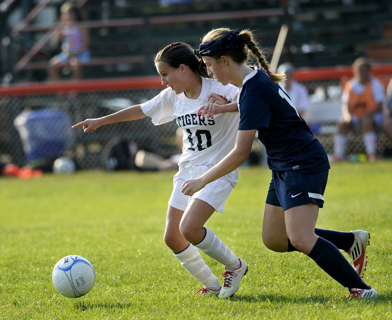 Olivia Paquette, left, who scored the winning goal for Biddeford, competes with Alexa Lynham of Westbrook for the ball Wednesday during Biddeford's 3-2 victory.