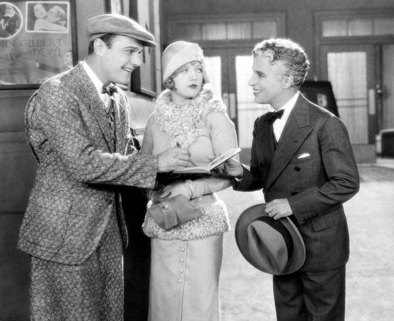 "William Haines, left, Marion Davies and Charlie Chaplin in the 1928 silent comedy ""Show People."""