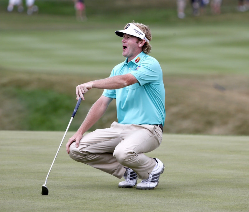Brandt Snedeker can't believe it as he misses a putt Thursday at the BMW Championship at Lake Forest, Ill. Tied for third place is Tiger Woods, who trails by three strokes.