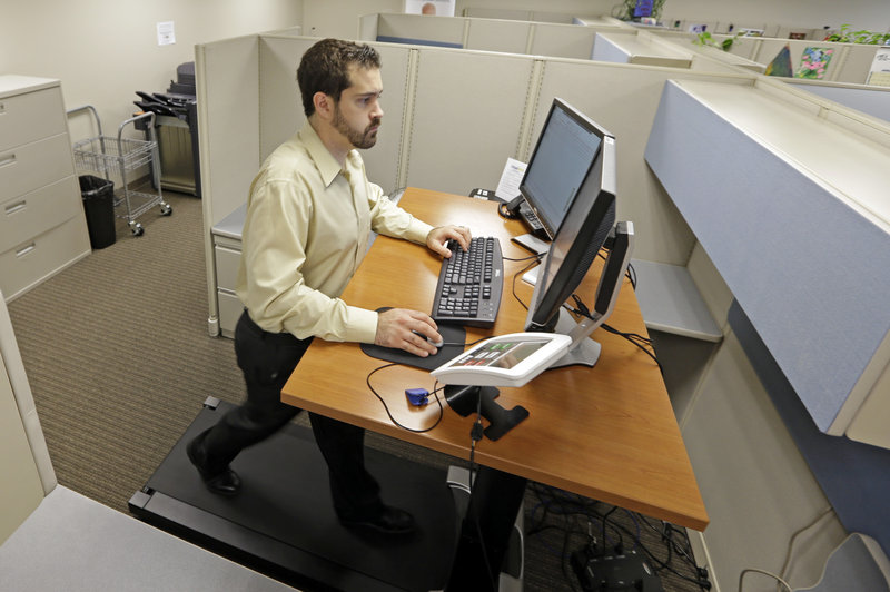Josh Baldonado, an administrative assistant at Brown & Brown, an insurance consulting firm in Carmel, Ind., works at a treadmill desk. Treadmill desks designed for the workplace are normally set to move at 1 to 2 mph, enough to get the heart rate up.