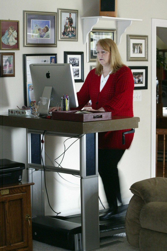 Mary Gagnon uses a treadmill desk at her home in Danville, Calif.