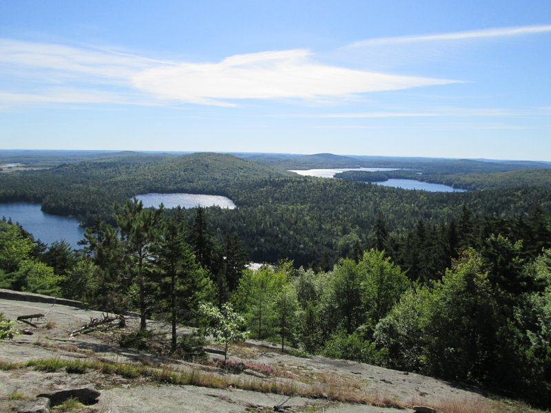 Hikers who opt to continue to Tunk Mountain's summit ridge will be treated to the kind of scenic vista that's rare outside of Maine's largely unspoiled north country. Recent amenities make the trek up the 1,157-foot mountain easier.