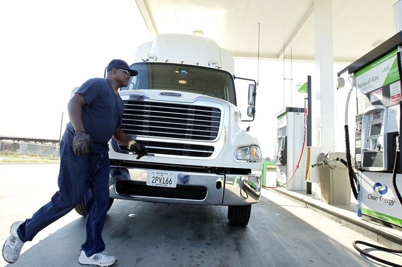 Trucker Gary Smith arrives to fill up at the Clean Energy natural gas station in Dallas, Texas, on September 3. Natural gas is considerably less costly than diesel fuel.