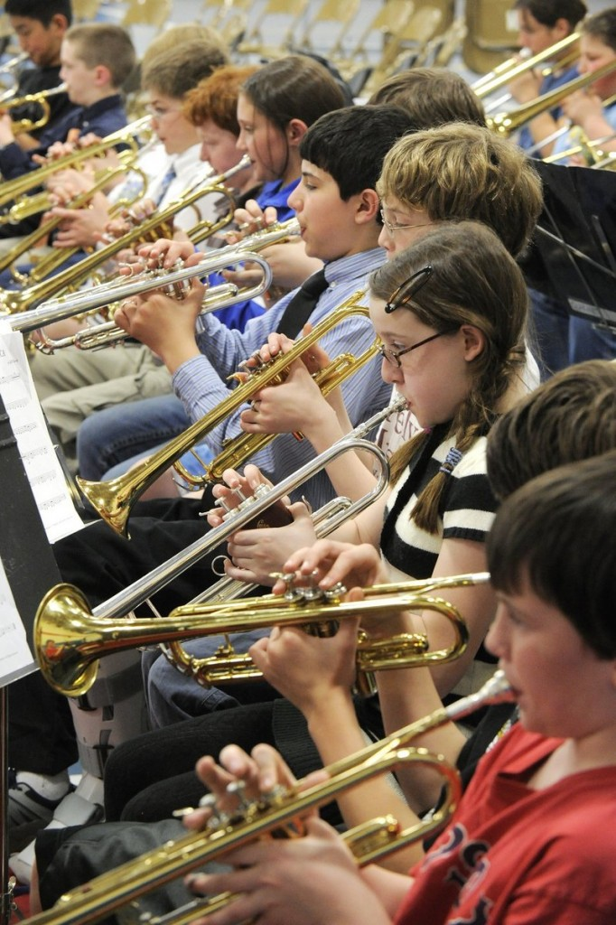 Band students from 40 schools rehearse for the District II Elementary Music Festival at Riverton Middle School in Portland in 2010. Handing a child a smartphone at a school concert or other performance distracts fellow audience members and is discourteous to those on stage.