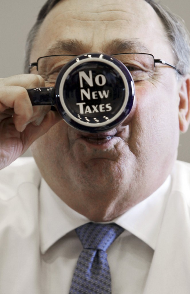 "Gov. LePage takes a sip out of a coffee mug displaying a ""no new taxes"" message in a 2012 file photo. By declining to accept Affordable Care Act funds to expand MaineCare eligilbility, the governor and his Republican allies in the Legislature saved Maine taxpayers money, a reader says."