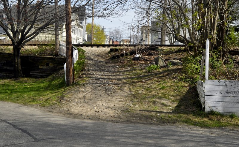 A man was killed by an Amtrak passenger train in April 2012 near this pedestrian cut-through from West Cutts Street to Cutts Street in Biddeford. Since 2003, trespassing on rail lines in Maine has led to 10 deaths and five serious injuries.