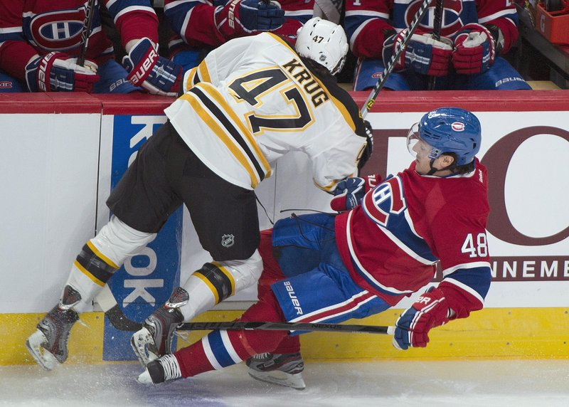 Montreal's Daniel Briere is knocked to the ice by Boston's Torey Krug during the first period of Monday's preseason game in Montreal, won by the Bruins.