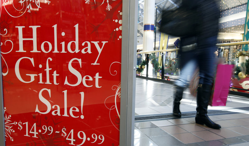 A research firm predicts stores like this one in Cambridge, Mass., will see modest revenue growth this holiday season.