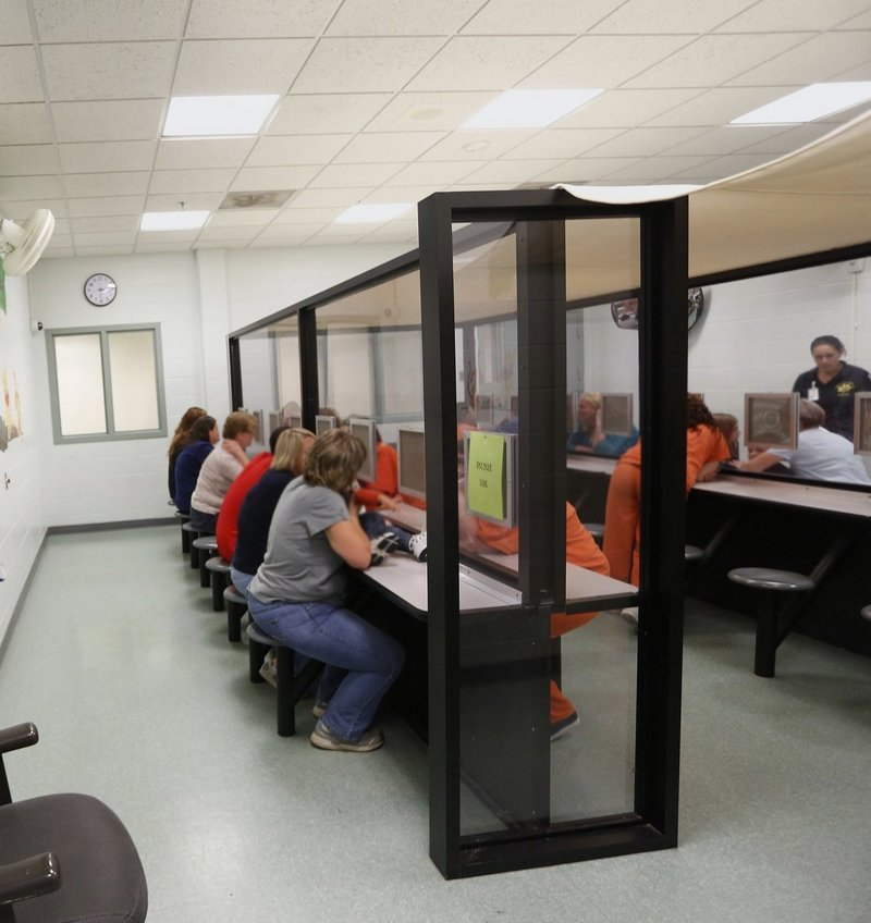 Inmates meet with visitors at the Cumberland County Jail. By creating a panel to study Maine's unified jail system, the state is abdicating responsibility for policymaking, a reader says.