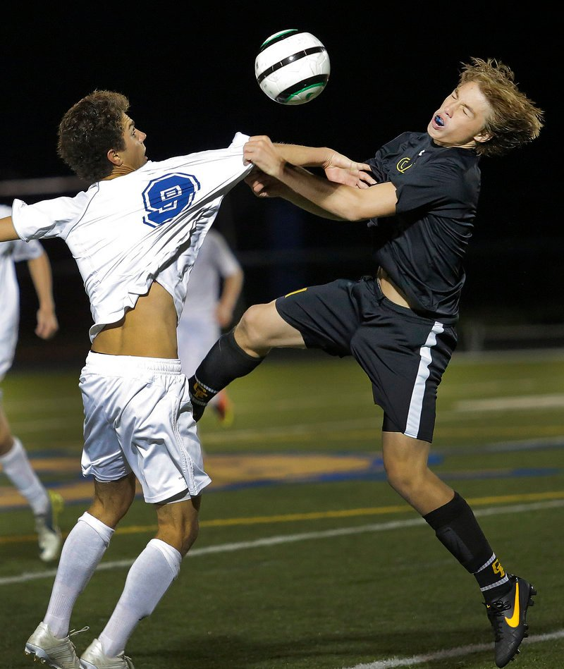 Falmouth's Ben Lydick, left, and Cape Elizabeth's Owen Thoreck battle for position during Wednesday night's Western Maine Conference boys' soccer game at Falmouth. The game ended scoreless.