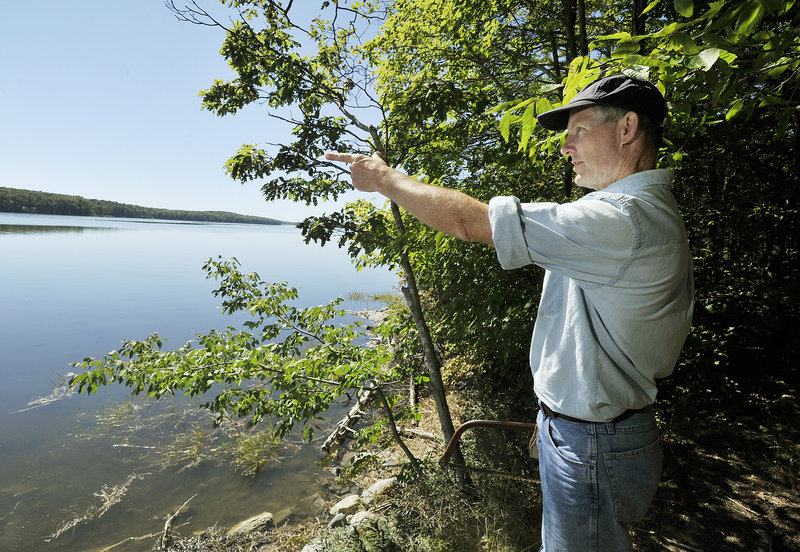 Henry Heyburn points to Westport Island as he leads a hike on the Eaton Farm Trail.