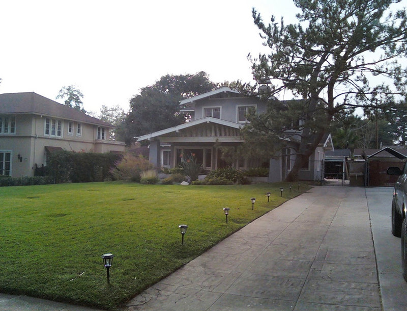 Before the makeover, cracks and roots breaking through marred the original concrete driveway at the Craftsman-style house.