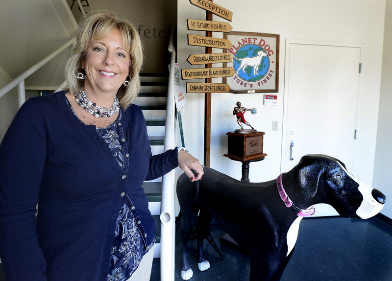 Colleen McCracken, the new co-chief executive officer of Planet Dog, is shown at the headquarters in Westbrook.