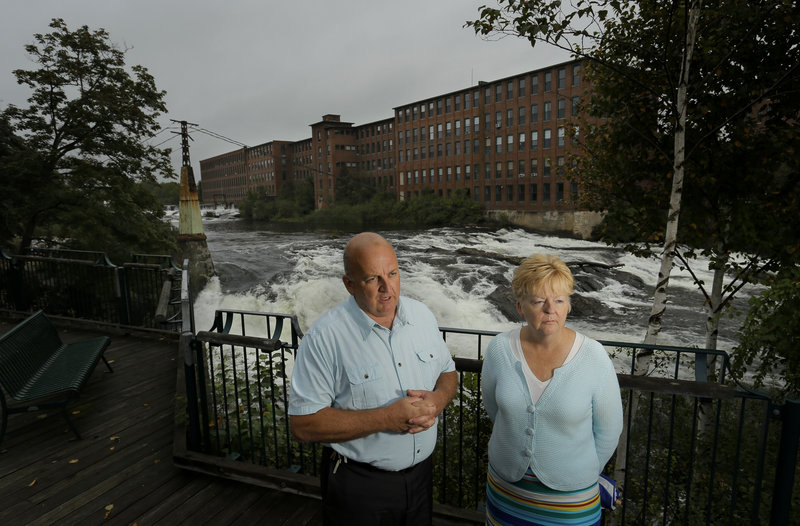 Westbrook Mayor Colleen Hilton and William Baker, assistant city administrator, talk about the economic future of Westbrook while standing in Saccarappa Park. If Westbrook can turn its downtown into an attractive place to live and work, it could replace all the jobs that were lost as paper mill employment decreased.