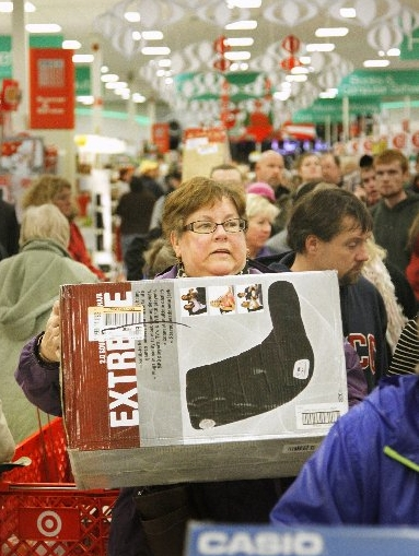 A Black Friday shopper is shown at Target in South Portland. Target plans to hire fewer seasonal workers.
