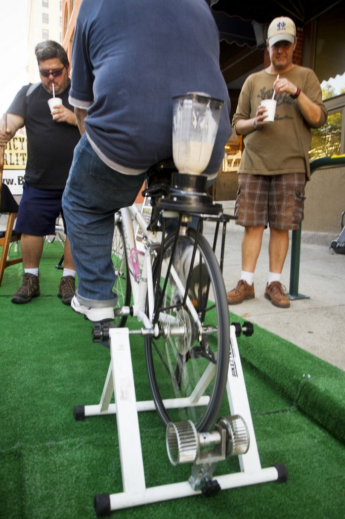 Frank Dorazio (L) and Brian Chabak of Portland (R) enjoy a milkshake made with peddle power in a parking space outside the Bicycle Coalition of Maine Preble Street office Friday. Sept. 20, 2013 during Portland's second annual Park(ing) Day. Taking place in nearly 200 cities around the world, people take over parking spaces for to hang out and have fun.