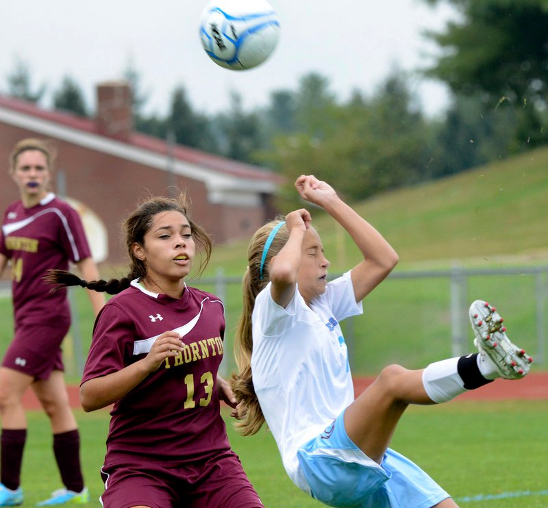 Holly Spencer, right, of Windham reacts after deflecting the ball past Thornton Academy's Allie Pettaway.