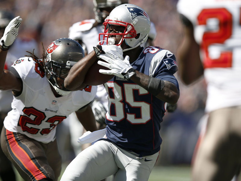 New England Patriots wide receiver Kenbrell Thompkins runs past Tampa Bay Buccaneers strong safety Mark Barron for a touchdown after catching a Tom Brady pass Sunday.