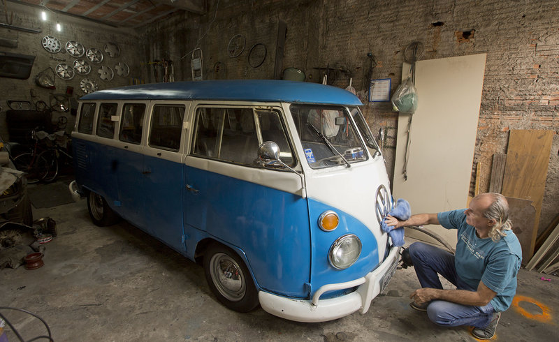 Enio Guarnieri wipes the VW emblem of his 1972 Volkswagen van in Sao Paulo, Brazil. Guarnieri bought the vehicle a year ago for sentimental reasons: When he was 10 years old, his father taught him to drive a Volkswagen bus.