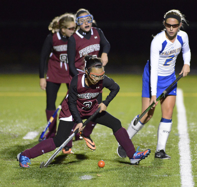 Lee Brown of Freeport passes the ball in front of Falmouth's Jillian Rothweiler. Falmouth recorded its sixth shutout in seven games this season.