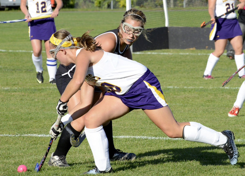 Abby Ford of Cheverus attempts to push the ball away from Karissa Boesch of Marshwood. Colleen Slattery of Cheverus scored the goal.