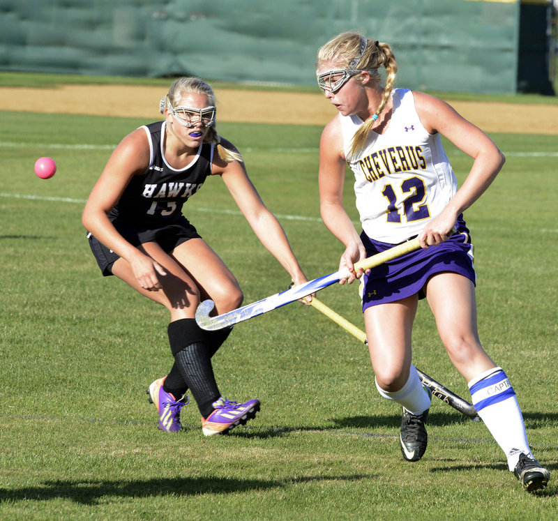 MaryKate Slattery of Cheverus watches the field hockey ball Tuesday while covered by Ashley Hickey of Marshwood during their SMAA game at Cheverus High. Cheverus won 1-0 to improve to 6-1. Marshwood dropped to 6-2.