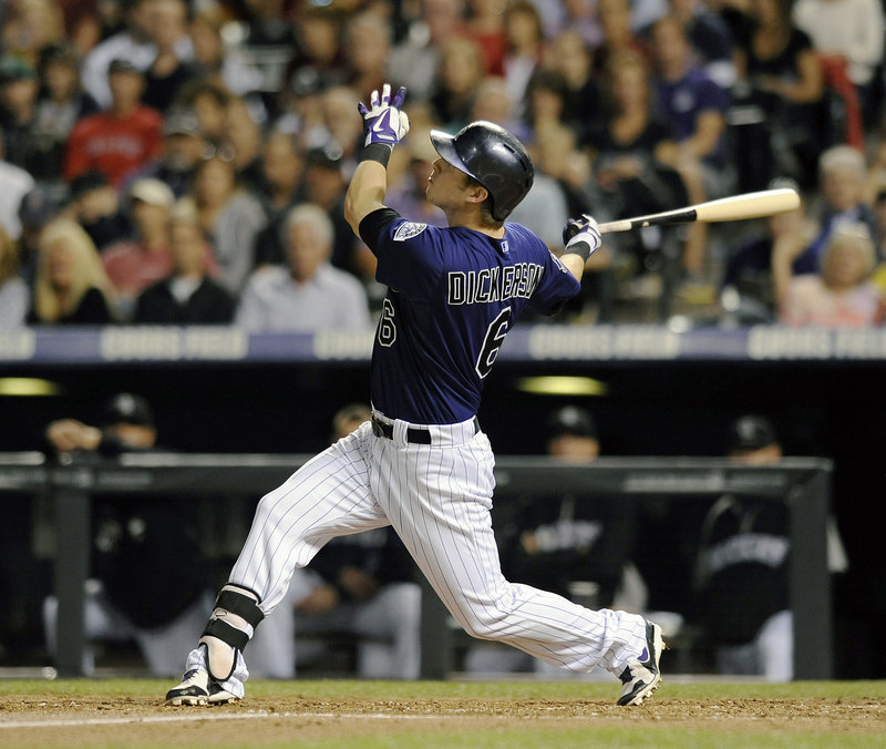 Corey Dickerson of the Colorado Rockies connects for a solo homer off John Lackey in the fourth inning Tuesday night during an 8-3 victory against the Boston Red Sox.