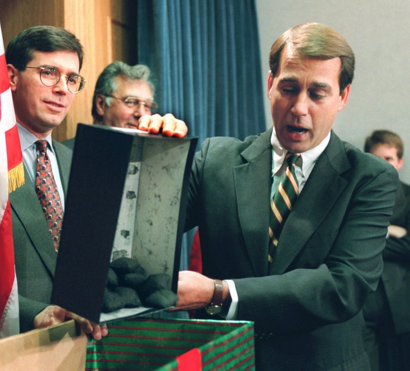 In 1995, Rep. John Boehner, R-Ohio, opens a box of coal, which he said would be a Christmas gift for President Clinton. At the time, Republicans in Congress were engaged in a standoff with Democrats over the budget that had led to a six-day partial shutdown. Democrats are hoping the current, similar standoff will help them at the polls.