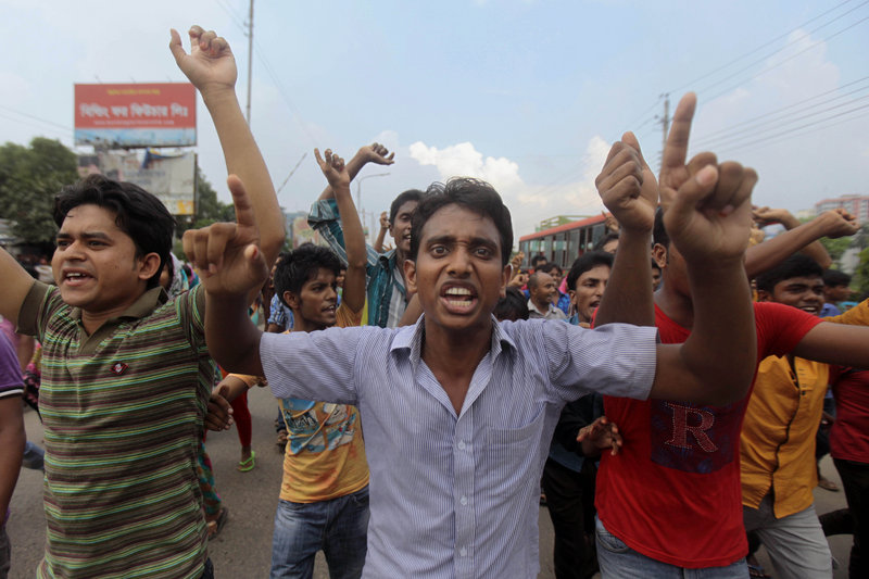 Bangladeshi garment workers protest in Dhaka on Monday. The workers are demanding $100 instead of the current monthly minimum wage of $38, which is the lowest in the world. Bangladesh is the world's second-largest garment manufacturing country after China.