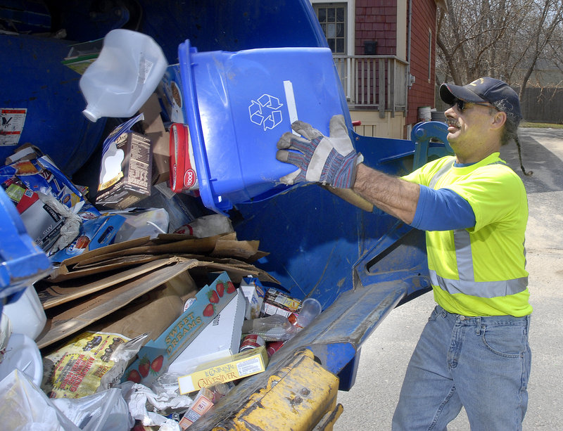 A Portland Public Services worker dumps a container of recyclable material into his truck during trash and recycling pickup in 2008. Requiring residents to put all recyclables in the bins will lead people to throw away items that don't fit in the bins, a reader says.