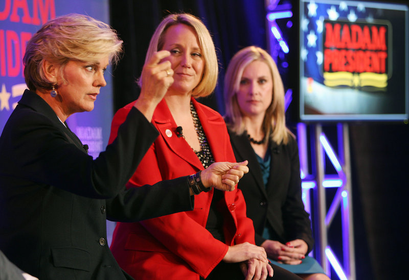 Former Michigan Gov. Jennifer Granholm, left, speaks at an Emily's List town hall discussion entitled