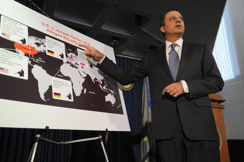U.S. Attorney Preet Bharara announces the charges against former American soldiers and a former German soldier during a news conference on Friday in New York.