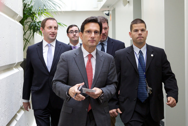 House Majority Leader Eric Cantor of Virginia walks out of a Republican caucus at the Capitol in Washington on Saturday. Lawmakers from both parties urged one another in a rare weekend session to give ground in their fight over preventing a federal shutdown.