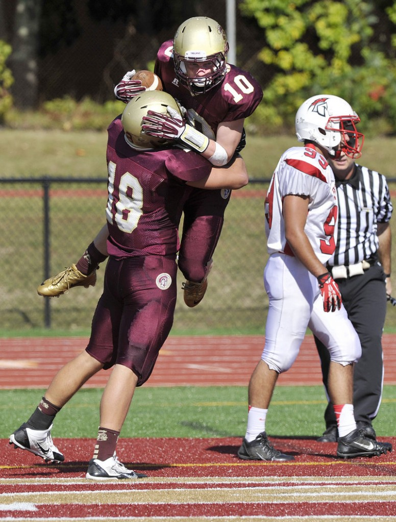 Carter Davis of Thornton Academy receives a lift from Cody Lynn after catching a touchdown pass in the second quarter of a 25-9 victory against Sanford on Saturday.