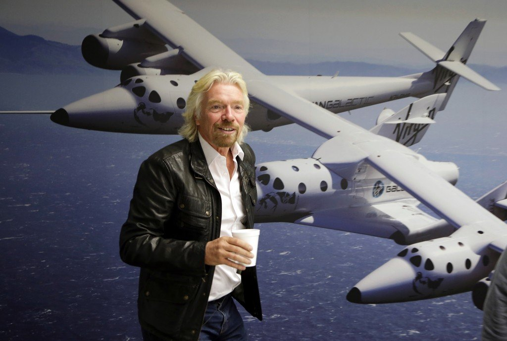 """Entrepreneur Richard Branson stands in the Virgin Galactic hangar at Mojave Air and Space Port in California. He's teaming with TV producer Mark Burnett on """"Space Race."""""""