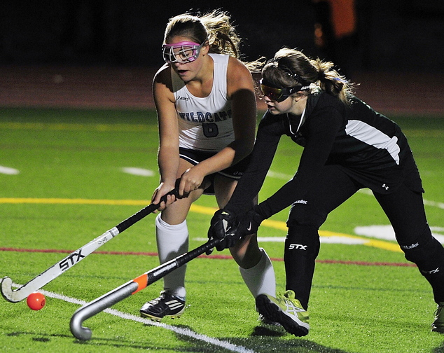 Alexandra Jones, left, of York battles with Spruce Mountain's Elizabeth Chretien. York will play Nokomis for the state title Saturday at Yarmouth High.