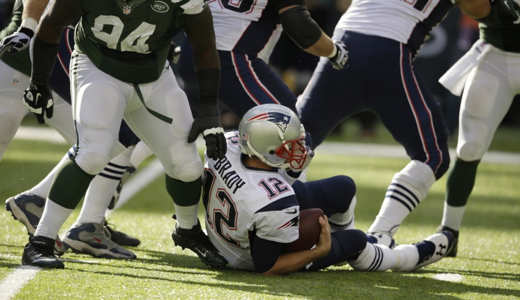 Tom Brady is sacked by the Jets' Damon Harrison (94) during the second half of New York's overtime win – one of four times the Jets put the New England quarterback on the ground.