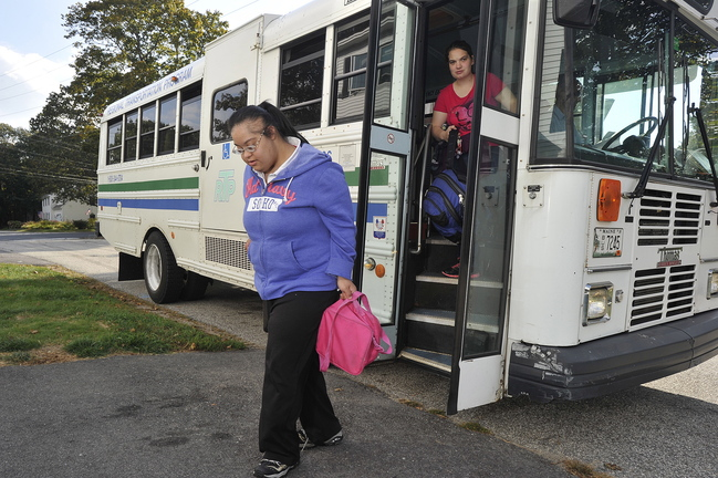 """Sheena Patel, 27, is dropped off at her South Portland home by an RTP bus after her day at """"Affinity,"""" an outpatient rehabilitation facility in Portland."""