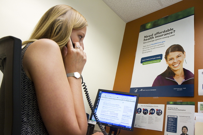 Carl D. Walsh/Staff Photographer With the health insurance marketplace open for business, Outreach Specialist Libby Cummings, at Portland Community Health Center, answers questions on the phone about the new system on Tuesday, October 1, 2013.