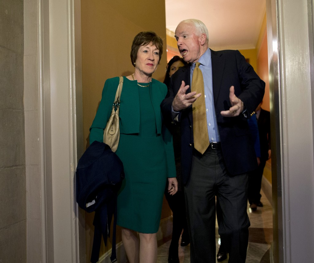 Sen. Susan Collins, R-Maine, talks with Sen. John McCain, R-Ariz., after arriving on Capitol Hill Friday following a meeting between Republican senators and President Obama at the White House. Collins has authored a 23-page proposal that would end the government shutdown and extend government funding for six months.